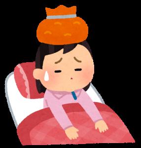 インフルエンザにかかり寝込んでいる女性